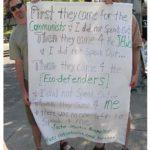 Protestors w/sign