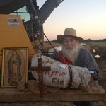 Fourth Generation Oklahoman Catholic Worker Locks Himself to KXL Machinery
