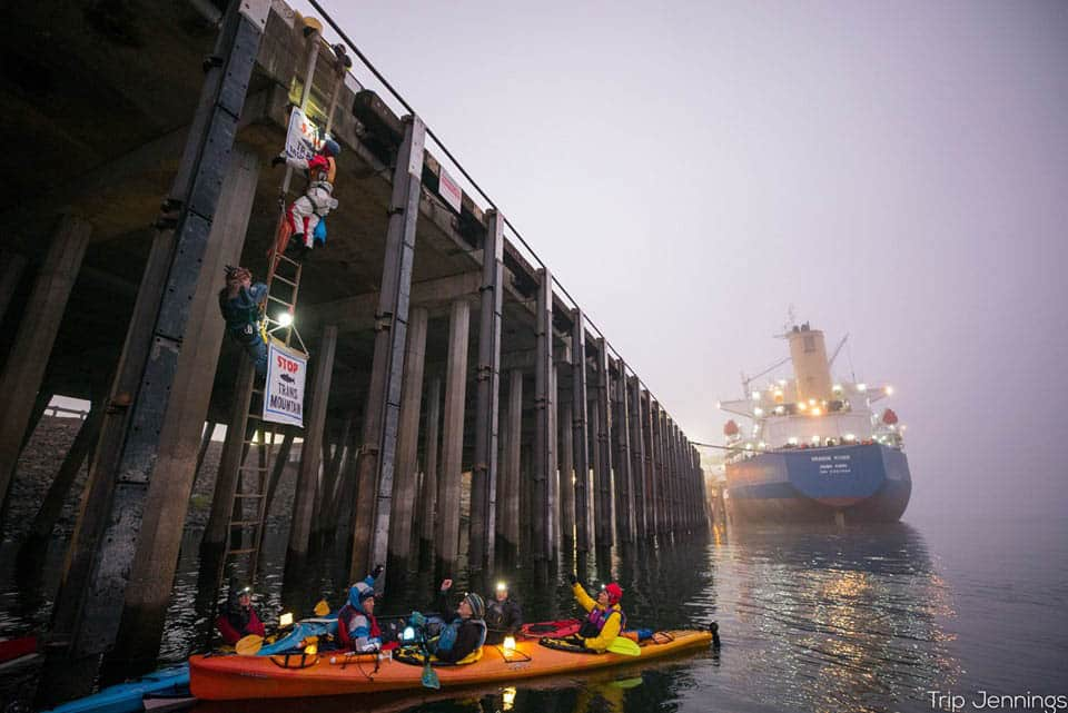 Protesters with the activist groups Mosquito Fleet and Portland Rising Tide attempting to block a ship from docking at the Port of Vancouver to offload oil pipe supplies in 2019.