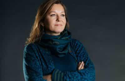 Portrait of Lauren Regan with gray backdrop.