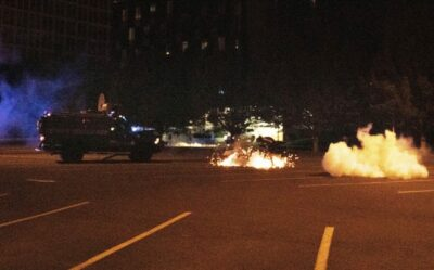 Eugene Weekly reported Henry Houston is struck by an apparent tear gas shell fired from a Eugene Police Bearcat Vehicle. Photo by Dana Sparks